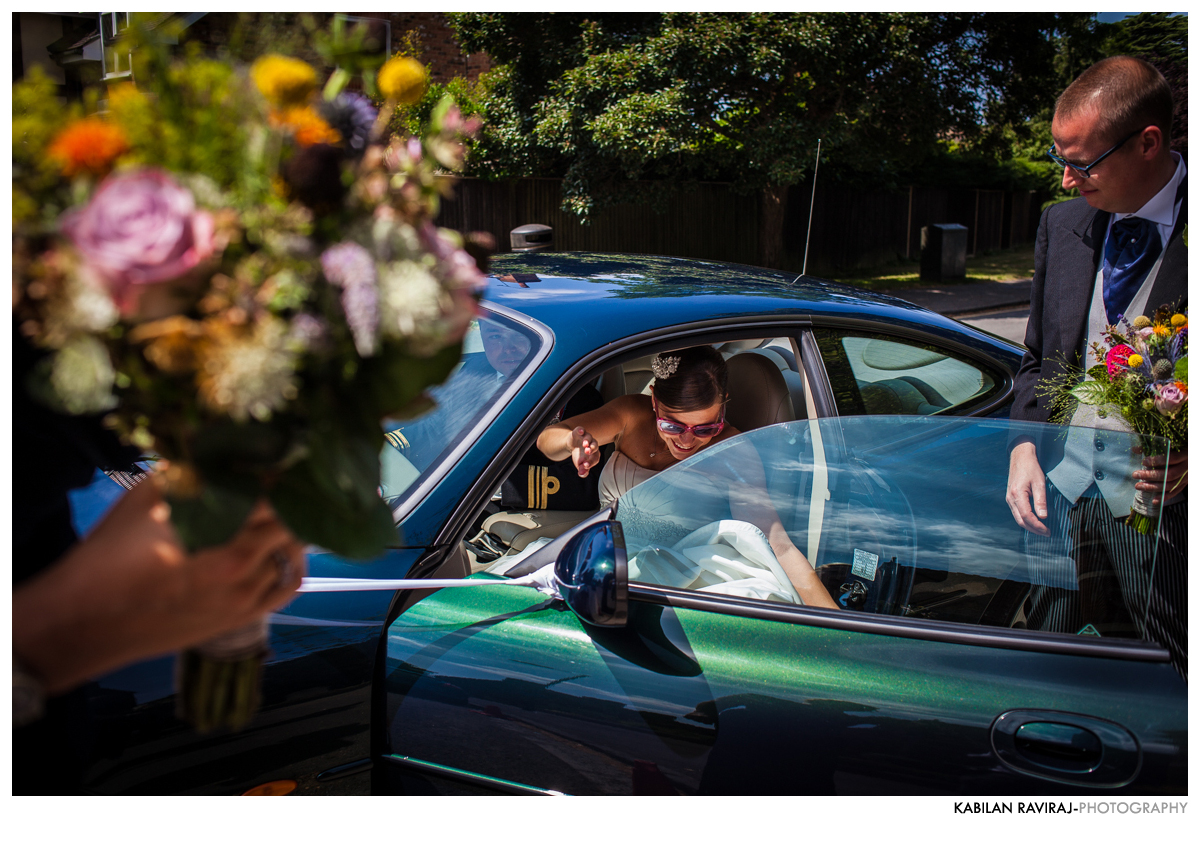 bride getting out of car